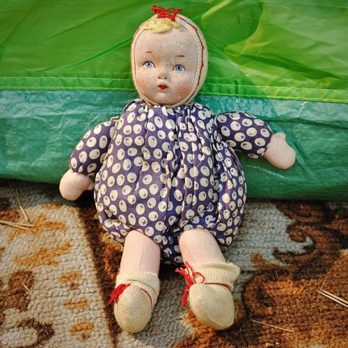 High Angle View Of Doll On Carpet At Home