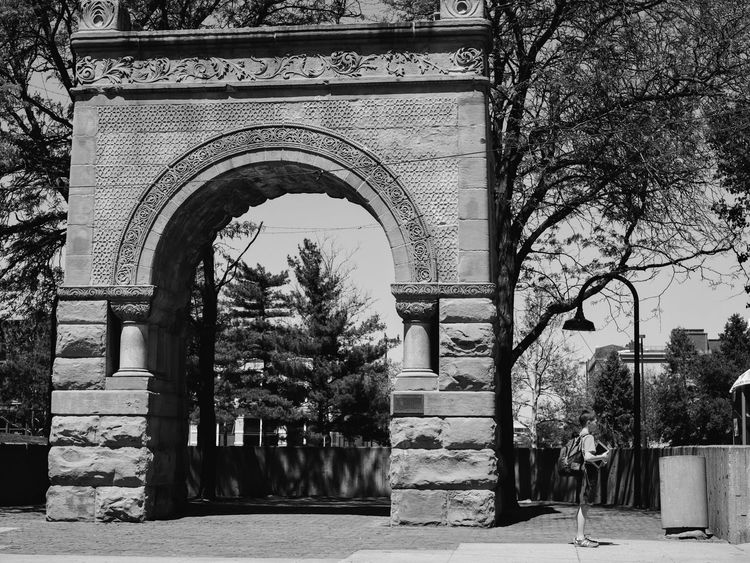 Former U.S. National Bank Arch. This archway is the former entry arch of the United States National Bank building that was located at 12th and Farnam Streets, one block west from this point. http://www.waymarking.com/waymarks/WMCQAN_Former_US_National_Bank_Arches_Omaha_NE Arch Architecture B&w Street Photography Berkshire Hathaway Built Structure Central Park City Documentary Documentary Photography Downtown Downtown District Gene Leahy Mall Lifestyles Money Around The World Omaha Omaha, Nebraska Outdoors Photojournalism Social Issues Streetphotography Woodstock For Capitalists