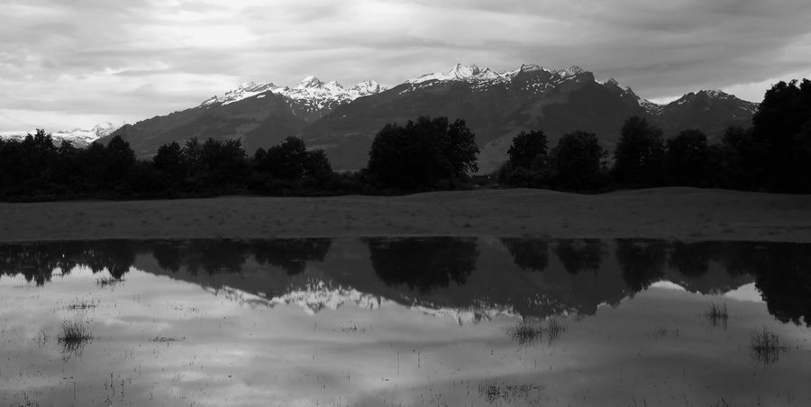 After the rain Blackandwhite Clouds And Sky Cloudy Flooded Flooded Fields Flooding June 2016 Mountain Range Pond Rain Rainy Days Reflection Reflection Rhine Valley Rural Scene Sennwald Sky And Clouds Standing Water Switzerland Symmetry Water Weather