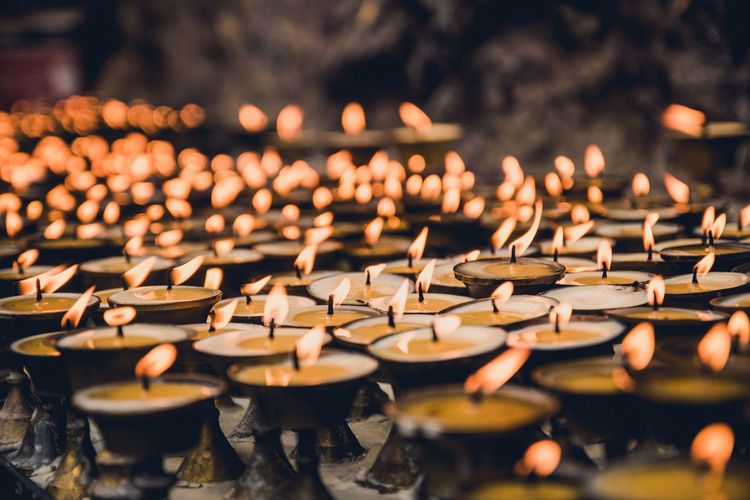 Burning Lit Tea Light Candles In Temple
