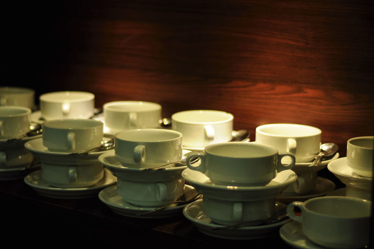 Close-up of empty coffee cups on table