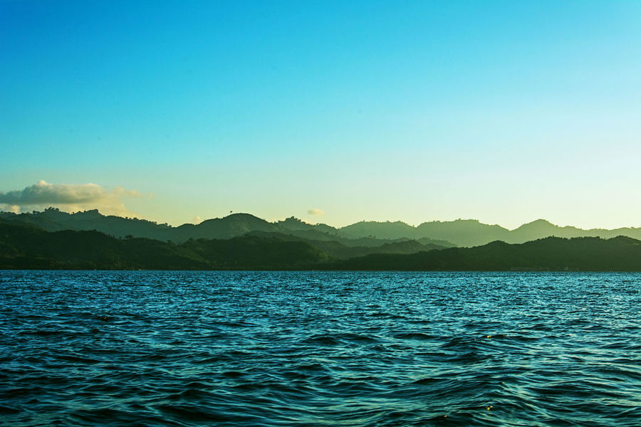 before sunset Beauty In Nature Blue Calm Day Hillside Idyllic Layer Layers And Textures Majestic Mountain Mountain Range Nature No People Non Urban Scene Non-urban Scene Outdoors Remote Rippled Scenics Sky Tranquil Scene Tranquility Water Waterfront