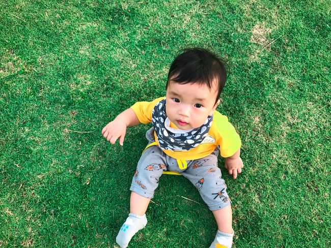 Cute baby Lifestyles People Kids Japan Asian  Green Color Grass Child Childhood One Person Real People High Angle View Green Color Grass Outdoors Front View Innocence Cute Full Length Baby Babyhood Looking At Camera Lifestyles Young Day Leisure Activity