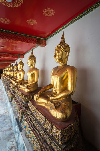Wat Pho , temple in Bangkok , Bangkok ,Thailand Art And Craft Buddha Creativity Famous Place Focus On Foreground Gilded Gold Gold Colored Golden Golden Color Human Representation Idol Indoors  Low Angle View Malaysian Culture No People Place Of Worship Religion Sculpture Spirituality Statue Temple Temple - Building Travel Destinations