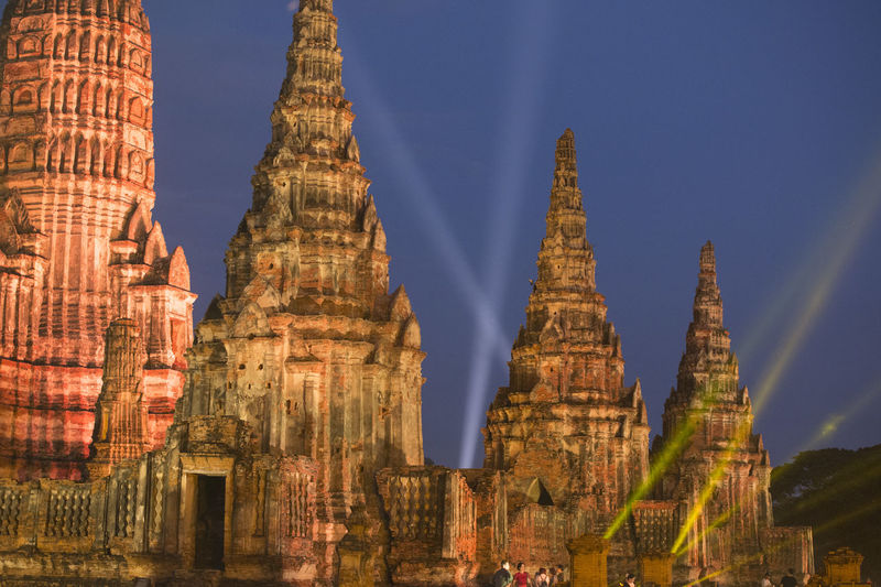 Low angle view of illuminated temples against sky at dusk