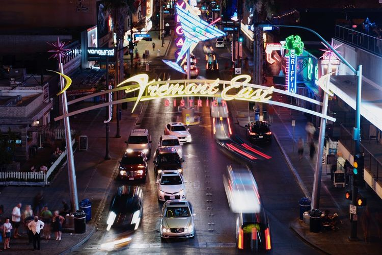 Fremont East district in downtown Las Vegas. Neon Party Business Bet Gamble Urban City Entertainment Cars Traffic Fremont East Fremont Street Night Sin City Vegas  Las Vegas Transportation City Mode Of Transportation Motor Vehicle Car Architecture Night Illuminated Street Road City Life High Angle View Traffic Motion