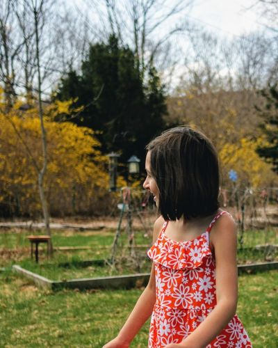 smiling in the yard. One Person People Outdoors Tree Rear View Nature One Young Woman Only Freshness Grass Nature Portrait Smiling Lawn Backyard Fun Happiness Youth Leisure Activity Backyard Yellow Flower Yellow Side View