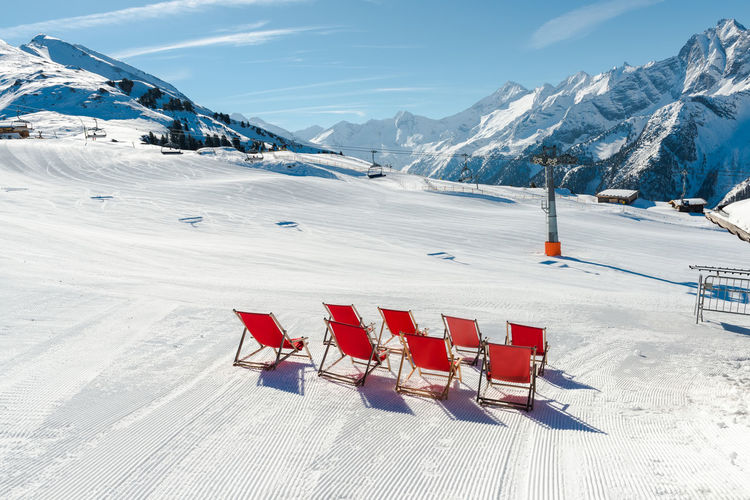 Empty red deck chairs on the snow in Mayrhofen ski resort, Austrian Alps Austin Austria Beauty In Nature Cold Temperature Day Mayrhofen Mountain Mountain View Nature No People No People, Outdoors Outdoors Photograpghy  Red Deck Chairs Relaxing Scenics Ski Resort  Ski Resort Hotel Sky Snow Tranquil Scene Tranquility Weather White Color Winter
