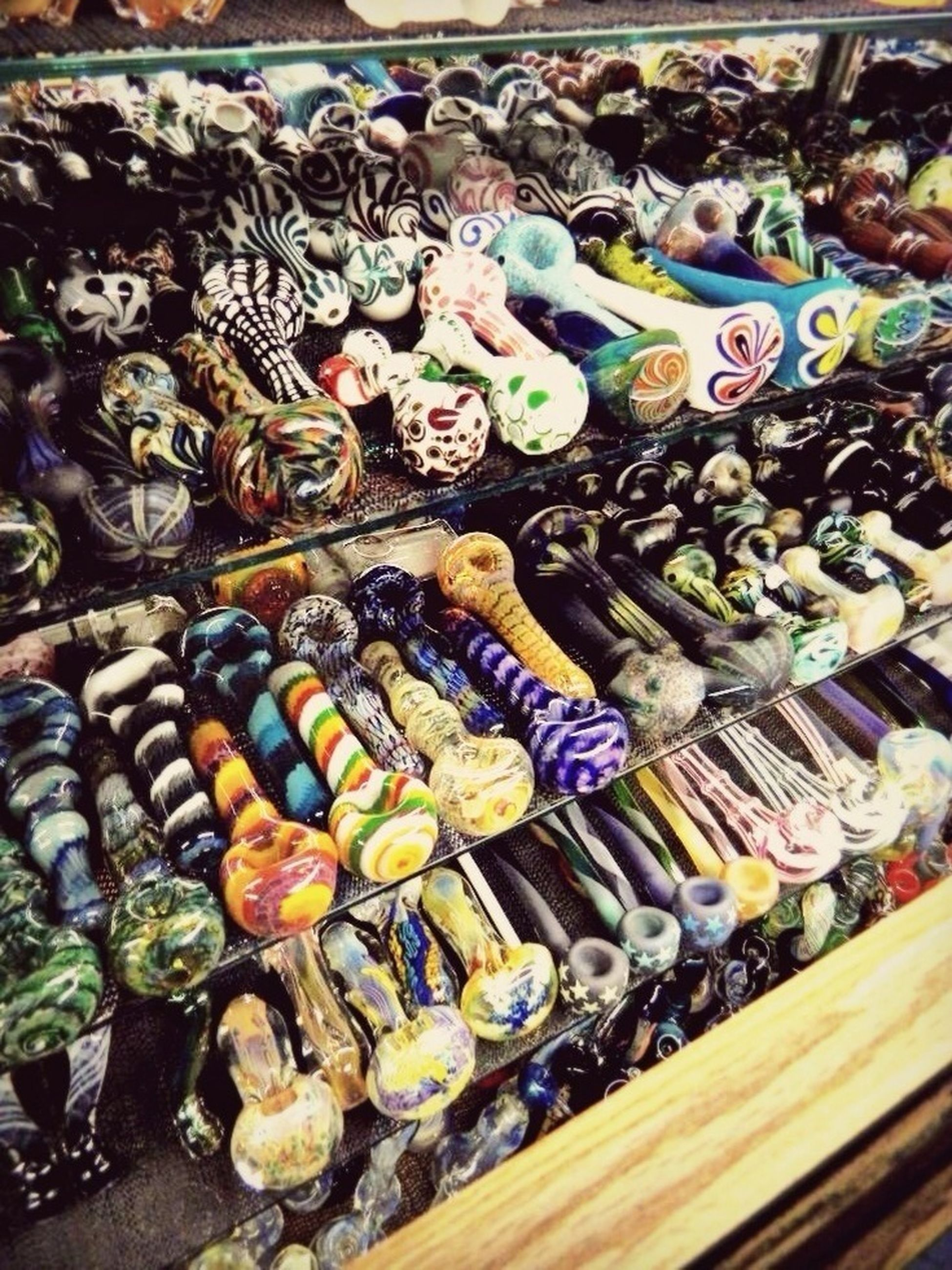 large group of objects, abundance, variation, high angle view, full frame, choice, for sale, backgrounds, still life, arrangement, collection, retail, market, multi colored, indoors, market stall, display, heap, no people, close-up