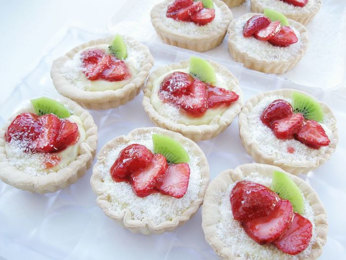 High Angle View Of Strawberry Tarts Arranged On Table