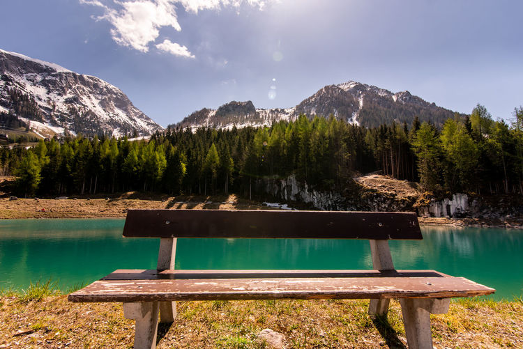 cold spring in alps Alps Germany Springtime Decadence Water Mountain Lake Tree Sky Landscape Bench Snowcapped Mountain Park Bench Rocky Mountains Mountain Peak Physical Geography