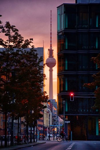 Berlin TV tower on an early weekend morning Bike Tree Building Architecture Tower Television Tower Television Tower Berlin TV Tower Tv Tower Berlin Sunup Sunrise Cityscape Citylife City City Life Road Street Streetphotography Lights Fernsehturm Fernsehturm Berlin  Skyline Tall - High Travel Destinations Reichstag Discover Berlin Connected By Travel Be. Ready.