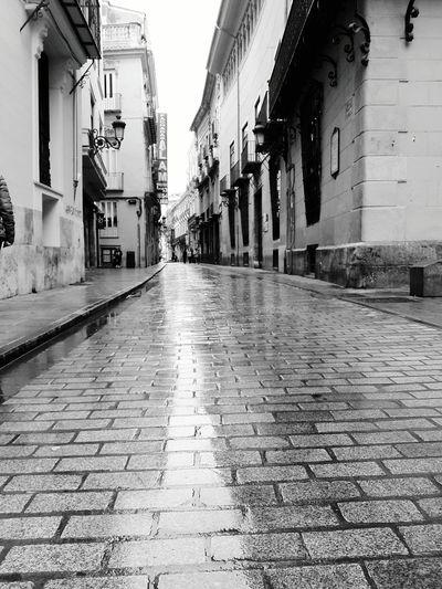 Rainy street in Valencia Street Building Exterior City The Way Forward Built Structure Valencia, Spain Valencia City Spain♥ Blackandwhite Blackandwhite Photography B&w Street Photography No People Road Rainy Days Rainy Street Low Angle View