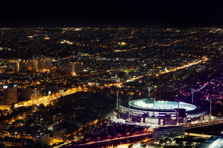 Melbourne, Australia - August 27, 2016: Aerial night view of the city and Melbourne Cricket Ground - home of Australian Football and the National Sports Museum Melbourne City Night Photography Aerial Aerial View Architecture Building Exterior Built Structure City Cityscape Cricket Ground High Angle View Illuminated Melbourne Modern Night Nightscape No People Outdoors Sky Skyscraper Travel Destinations Urban Skyline