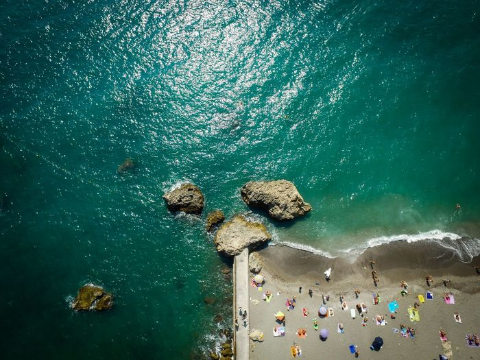 Aerial view of people by sea at beach
