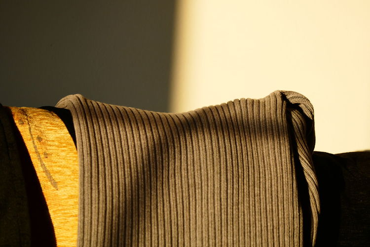 Close-up of sweater on sofa at home