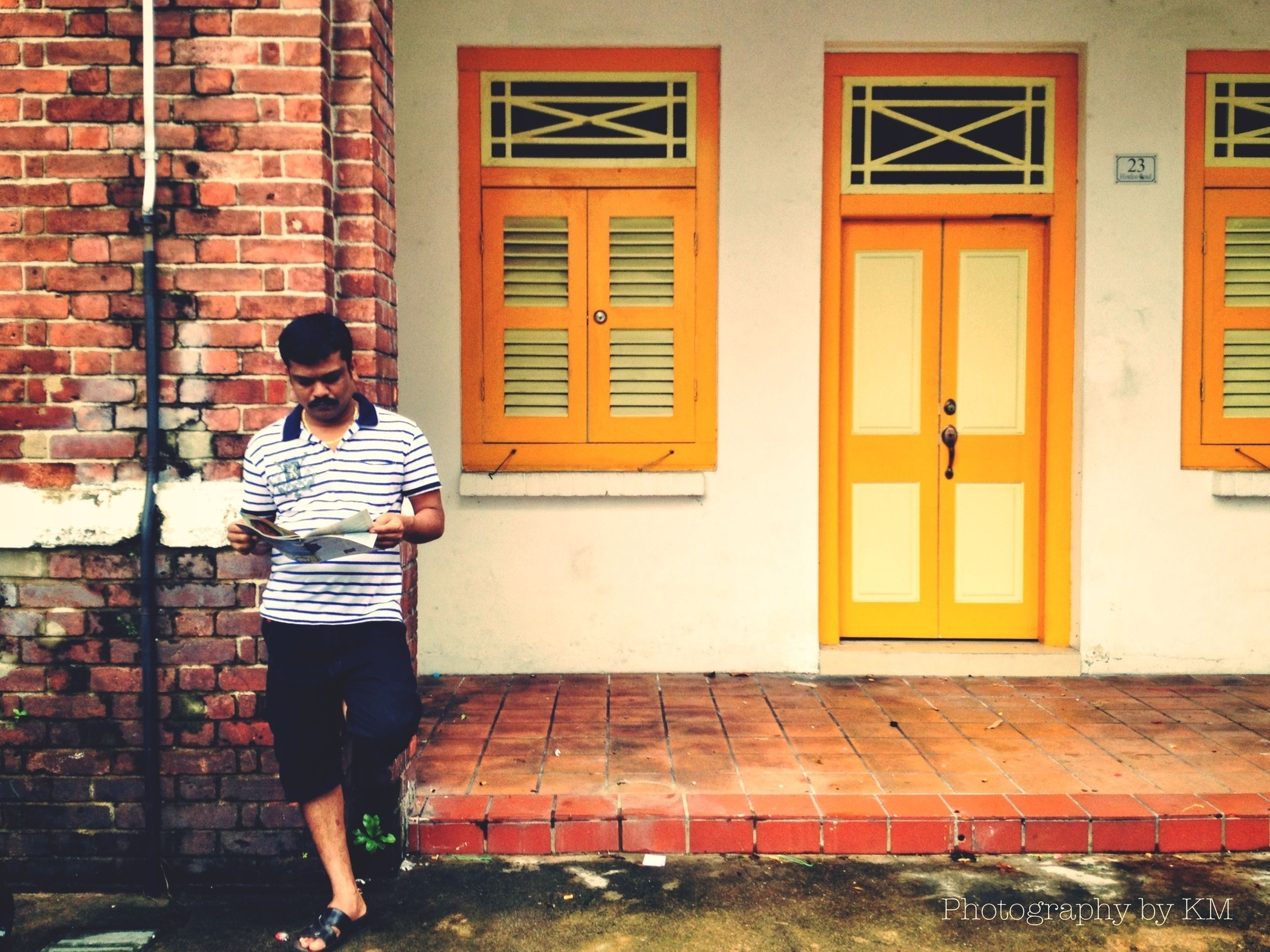 full length, lifestyles, casual clothing, building exterior, architecture, built structure, leisure activity, standing, side view, person, walking, childhood, wall - building feature, brick wall, elementary age, three quarter length, front view, boys