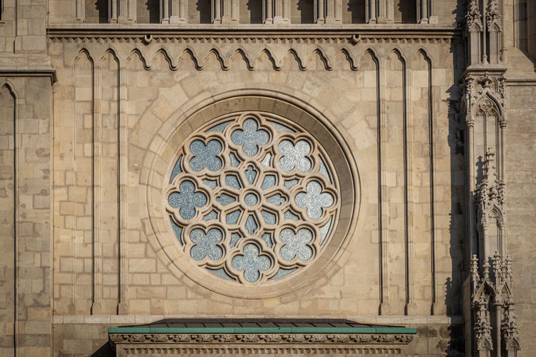 Low angle view of ornate window of building