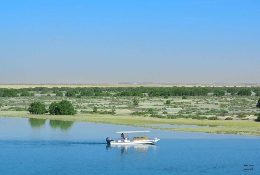 River boat EyeEm Nature Lover Water Sky Transportation Clear Sky Mode Of Transportation Copy Space Waterfront Nature Men Beauty In Nature Blue Outdoors