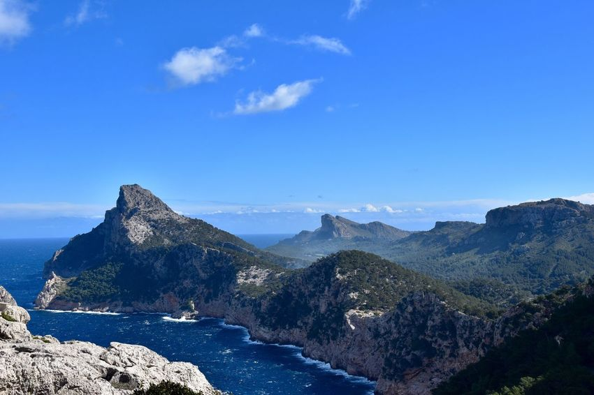 Betterlandscapes Mountain Scenics Nature Tranquility Beauty In Nature Tranquil Scene Blue Sky Day Water Mountain Range Outdoors No People Sea Landscape Sunlight Winter In Mallorca Mallorca (Spain) Travel Destinations Mallorca Tranquility Beauty In Nature D'es Colomer