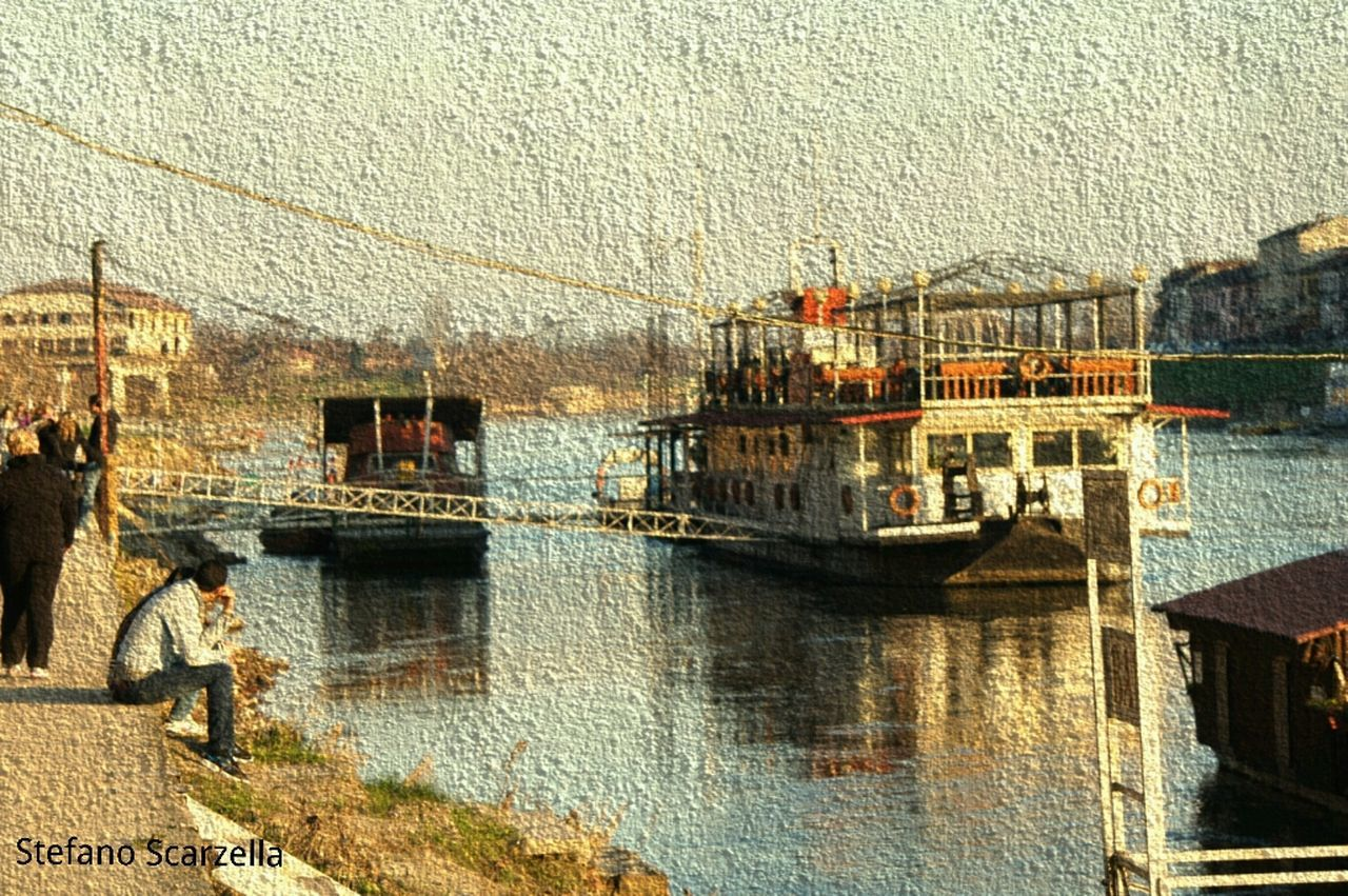 water, transportation, built structure, architecture, nautical vessel, outdoors, mode of transport, building exterior, real people, waterfront, day, nature, sea, sky, city
