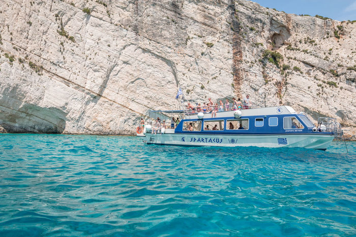 Boat in Navagio Beach Zakynthos GREECE ♥♥ Zakynthos Zakynthos Island Zakynthos, Greece Zakynthos,Greece Beauty In Nature Cliff Day Formation Group Of People Mode Of Transportation Mountain Nature Nautical Vessel Outdoors Passenger Craft Rock Rock - Object Rock Formation Sea Solid Tourism Transportation Travel Water Waterfront