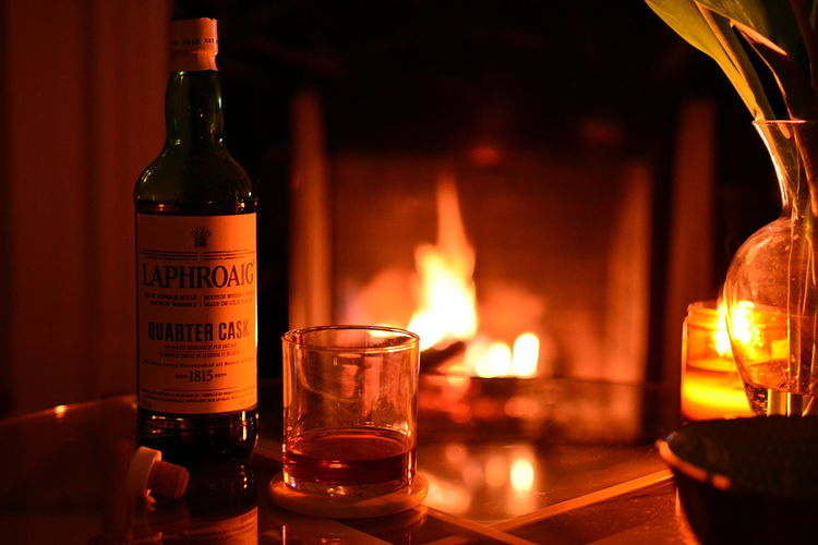 Flame Fire Burning Alcohol Bottle Fire - Natural Phenomenon Refreshment Food And Drink Drink Container Table Indoors  Glass Heat - Temperature Glass - Material Candle Focus On Foreground Household Equipment Close-up Wine Bottle No People Laphroaig