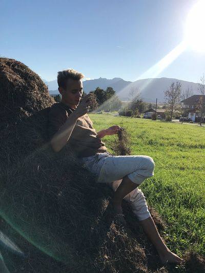 Rural Life Rural Scene Bavaria One Person Field Plant Sunbeam Outdoors Sunlight Lens Flare Young Men Casual Clothing Young Adult Nature Leisure Activity