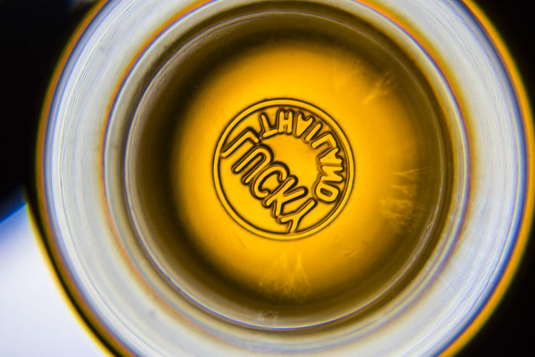 Wine glass Close-up Indoors  Refreshment No People Directly Above Finance Text Geometric Shape Wealth Circle High Angle View Business Shape Single Object Currency Drink Food And Drink Still Life Yellow Container Glass Crockery