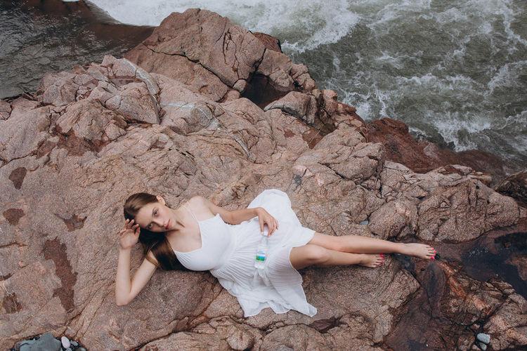 High angle view of woman on rock