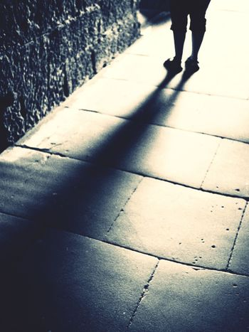 Footpath Silhouette Blackandwhite Black And White Blackandwhite Photography Low Section Shadow Body Part Human Leg Walking Human Body Part Real People One Person Sunlight Street