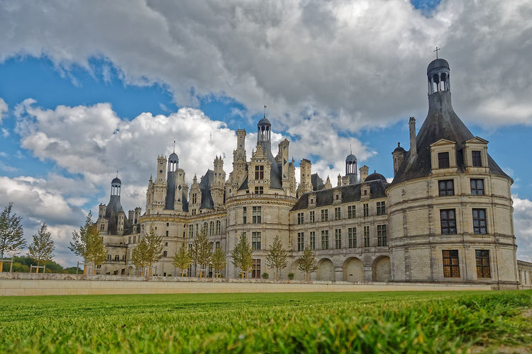 Chateau De Chambord Architecture Beauty In Nature Building Exterior Built Structure Castle Château Cloud - Sky Day Field Grass History Nature No People Outdoors Place Of Worship Sky Spirituality Travel Destinations