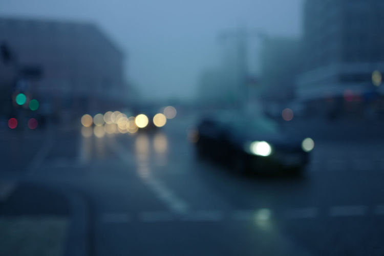 Defocused image of cars on road at night