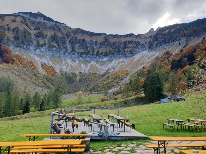 Seats and tables at Meyerlehenhütte on Gruber Alm with rock massif in Background. ... Alm Mountain Range Autumn Travel Autumn colors Postcard Autumn Colours Tourism Tourist Destination Wanderlust Travel Destinations EyeEm Selects Mountain Tree Sky Landscape Mountain Range Scenics Tranquil Scene Tranquility Idyllic Beauty In Nature Calm Rocky Mountains Non-urban Scene
