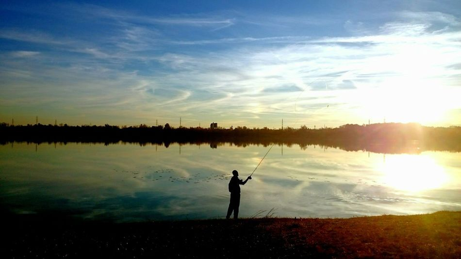 Old man's sea... First Eyeem Photo Places Random People Life Lake Fisherman Sunset Autumn Colours Colours Of Autumn Cellphone Photography Blue Wave Colour Of Life People And Places