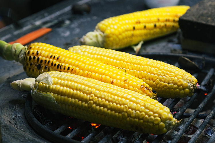 Close-Up Of Corns On Barbeque At Street Market