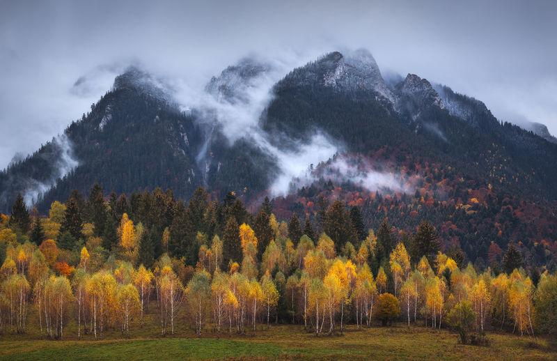 Autumn landscape with mountain villages near brasov, romania.