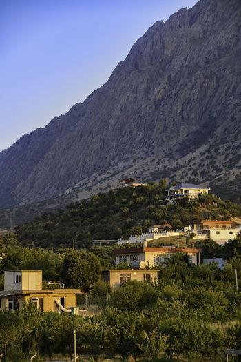 Houses against mountain