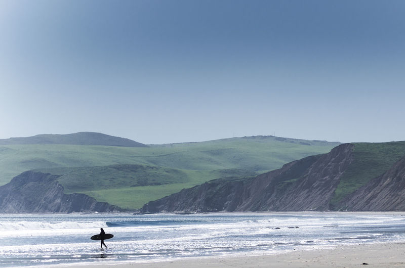 Surfing Landscape Beauty In Nature Landscape Leisure Activity Mountain Outdoors Remote Scenics Sea Surfing Tranquil Scene Unrecognizable Person Vacations Water My Favorite Photo