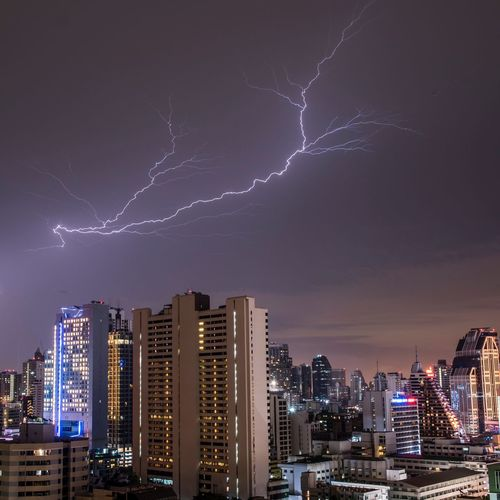 Building Exterior Architecture City Night Built Structure Building Cityscape Lightning Sky Illuminated Skyscraper Power In Nature Office Building Exterior Storm Urban Skyline Landscape Nature Cloud - Sky