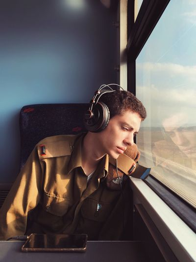 Army Dreamer Mytrainmoments Mydtrainmoments מייאייפון10 IPhoneX ShotOnIphone Window Young Adult Young Women Indoors  Looking Glass - Material Rail Transportation 2018 In One Photograph It's About The Journey Analogue Sound