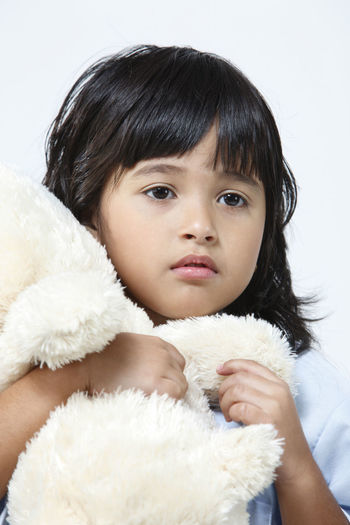malaysia malay girl with pyjamas holding teddy bear Asian  Females Hugging Innocence Bangs Black Hair Child Childhood Cute Elementary Age Girl Headshot Indoors  Malay Malaysia Offspring One Person Portrait Pyjamas Softness Studio Shot Stuffed Toy Teddy Bear White Background Women