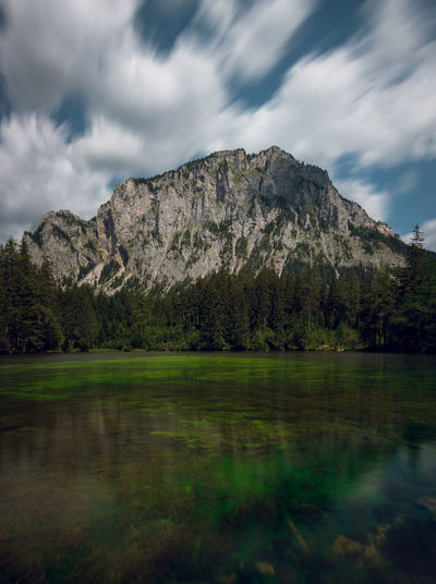 Grüner See in Austria daytime log exposure Water Cloud - Sky Sky Beauty In Nature Scenics - Nature Tranquil Scene Reflection Mountain Tranquility Lake No People Day Non-urban Scene Plant Nature Tree Waterfront Idyllic Environment Outdoors Grünersee
