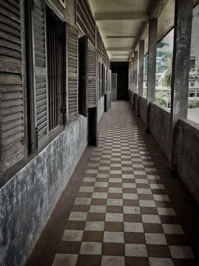 Corridors of Tuol sleng. Corridors  Tuol Sleng Genocide Museum Phnompenh Cambodia Torture Horror Khmerrouge Interrogation Execution Tiles Vanishing Point Diminishing Perspective