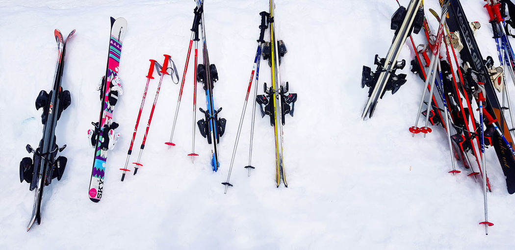High angle view of people skiing on snow covered field