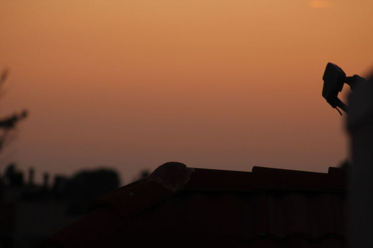 Roof Rooftop Sunset Silhouettes Sunset_collection Architecture Building Exterior Built Structure Day Human Body Part Human Hand Nature One Person Outdoors People Real People Roof Tile Rooftop View  Rooftops Silhouette Sky Sunset Sunset #sun #clouds #skylovers #sky #nature #beautifulinnature #naturalbeauty #photography #landscape Sunsets