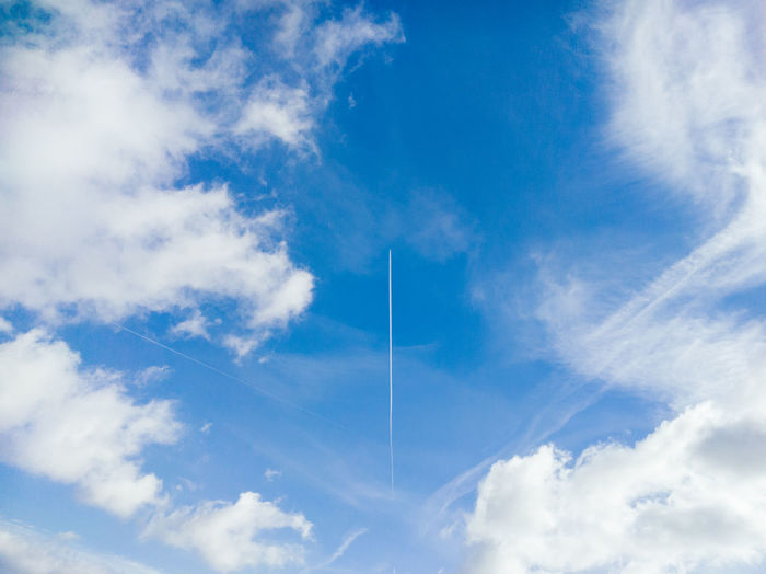 Low Angle View Of Vapor Trail In Blue Sky