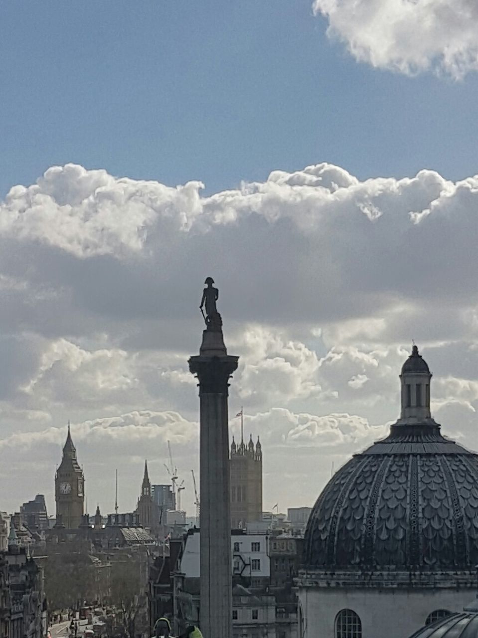 statue, human representation, sculpture, cloud - sky, sky, architecture, built structure, building exterior, no people, outdoors, day, city, travel destinations, cityscape