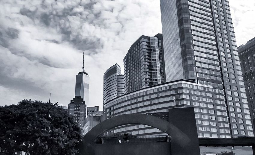 Street Photography Street Manhattan The Big Apple Blackandwhite Photography Blackandwhite World Trade Center Architecture Skyscraper Building Exterior Modern Built Structure City Low Angle View Sky Day Tree Cityscape Outdoors Cloud - Sky Travel Destinations No People