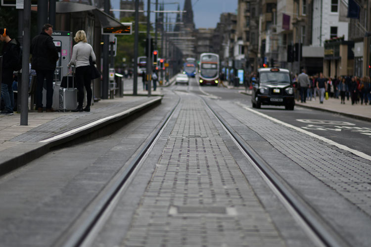 City Transportation Street Architecture Mode Of Transportation Group Of People Building Exterior Incidental People Real People The Way Forward Walking Men Direction City Life Lifestyles Day People Railroad Track Track Outdoors Surface Level Waiting Taxi Tram Tracks Edinburgh